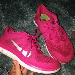Pink nike running shoes.